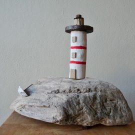 Leuchtturm mit Boot